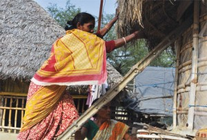Binota Munda and Kalyani Borkandas at their grain bank in Nebukhali village